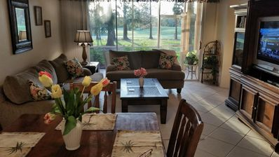 From  Dining area and Living room looking out 13th fairway Flamingo Country Club