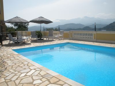 The pool and view across the hills towards the south west.