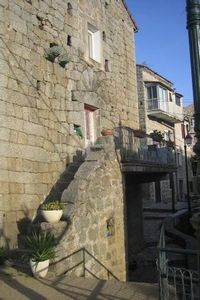 Photo for Fortified house (16th century tower) in the heart of a village in southern corsica