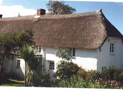 Photo for A beautiful 250 year old thatched cottage close to Frenchman's Creek. 2 bedrooms