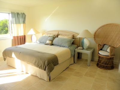 Master bedroom with new kind size bed and en suite bathroom with shower