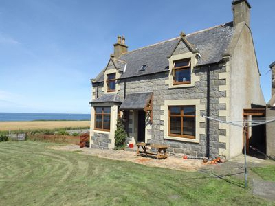 Front of house with view towards sea