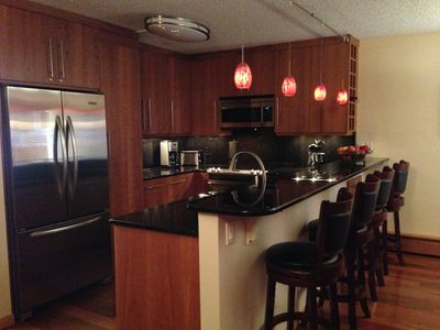 Complete kitchen with granite counter tops and stainless steel appliances.