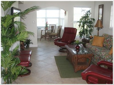 Tropical decor in main salon includes queen size pull out couch.