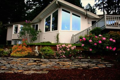 Beautiful Agate Beach House from professionally landscaped backyard