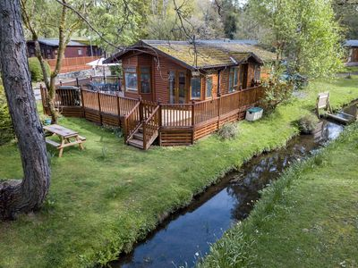 Photo for Luxury Log cabin in a tranquil setting situated on the shore of Lake Windermere