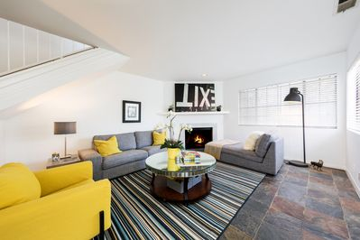 bright sunny living room with fire place : central air and heat throughout