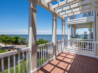 Photo for Spacious Sunset Island Townhome! 5BR, 4.5BA, WiFi, Canal View, Pools, Gym, Pier