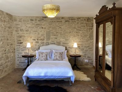 Bedroom 1 is stunning with its exposed stone walls