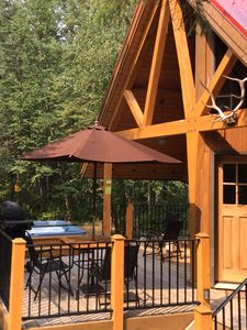 Front deck with private hot tub, BBQ and outdoor patio table with chairs