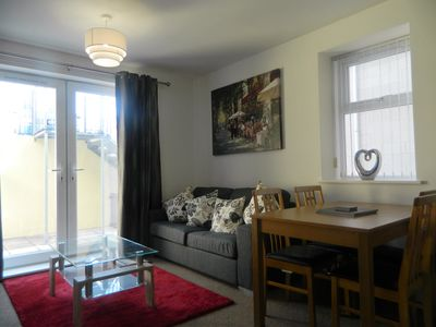 Living/dining area - with Patio doors leading to patio area.