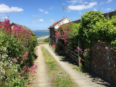 Photo for Old Saltys Cottage in Westward Ho with stunning sea views