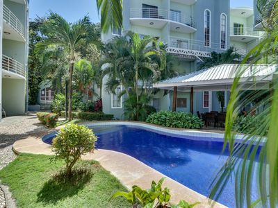 Photo for Relaxed condo w/ shared pool, fitness center & balcony - walk to beach!
