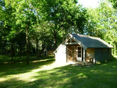 Photo for Wooden chalet on wooded land to 10 minutes from the sea