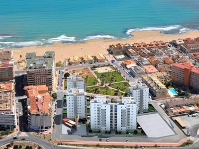 Photo for Modern ground floor apartment with 80m² terrace + parking at La Mata beach