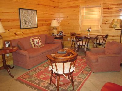 Large living room and kitchen combination with dining/game table.