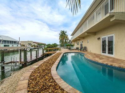 Photo for Salty Anglers, Spacious Sombrero Beach Waterfront 4 Bdrm w/Heated Pool & Dockage