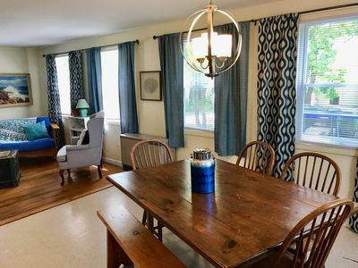Spacious, antique dining table for meals together.