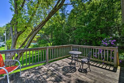 This vacation rental features a spacious deck area with lush views.