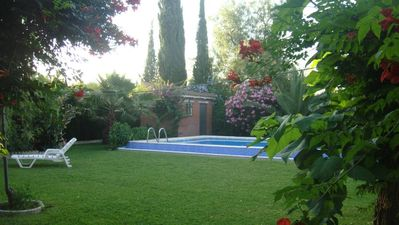 Photo for Beautiful villa of 200m2 20 minutes from Seville, 8 people, garden 1200m2, wifi.