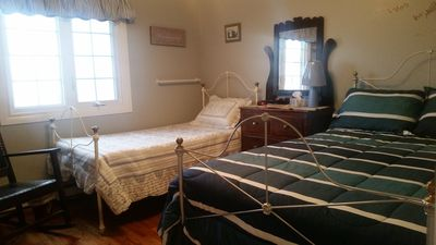 Enjoy the comforts of Skippers Quarters, featuring antique double & single bed.