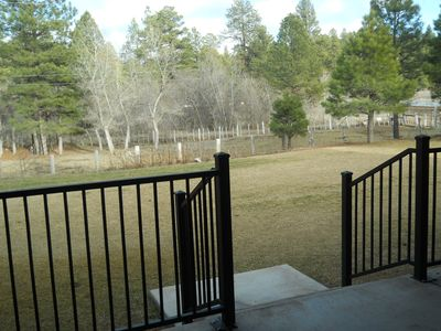 Covered patio looking over backyard and horse pasture