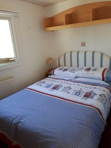 The double bedroom has a full size double bed, wardrobe and dressing table