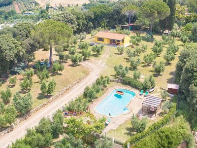 Photo for House with pool, Typical Tuscan typical house on top of a hill adjacent to the ancient village of Bibbona