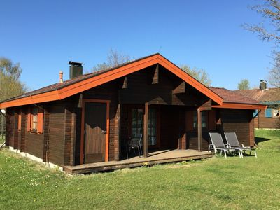 Photo for Inviting wooden bungalow with tiled stove in holiday park with a large play area