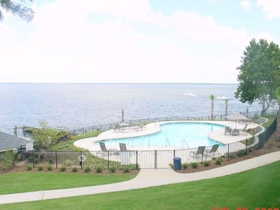 Sit on the porch and overlook the pool and big waters of Santee's Lake Marion