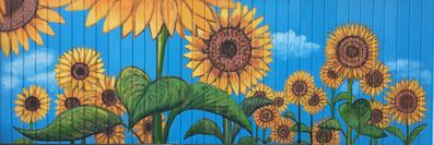 Sunflower mural by renowned local artist, Judy Perry