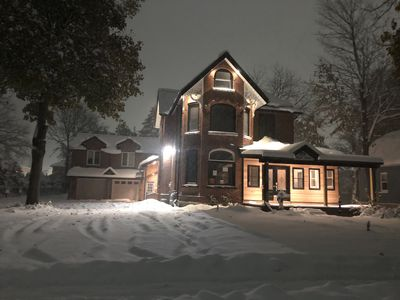 The Maple House by night.
