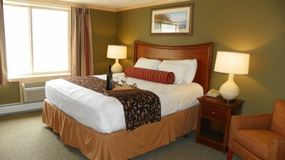 King Bed to relax after exploring the White Mountains-similar unit pictured