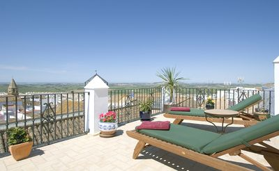 Photo for 5 bedroom Andaluz Patio House, private pool, view to sea, sleeps up to 12 guests