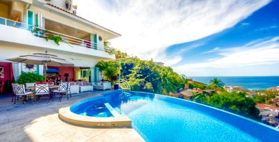 Photo for Villa Yvonneka-12 bed villa, stunning mountain and ocean views, heated pool, jacuzzi