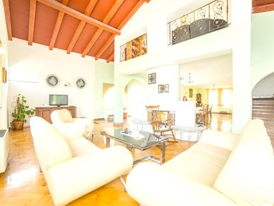 Photo for Homerez last minute deal - Big apt with swimming-pool and garden
