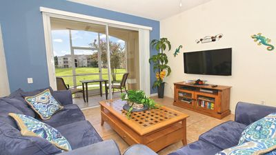 """Living room includes sleeper sofa, DVD player, and wall mounted 46"""" LED TV."""