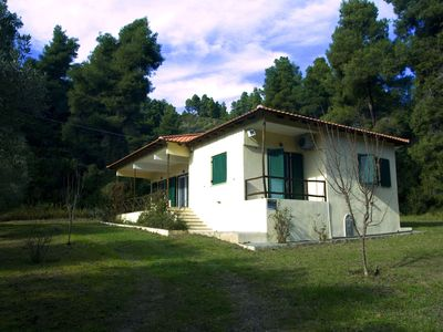 Photo for Within a pure pine forest and short walking from a crystal beach