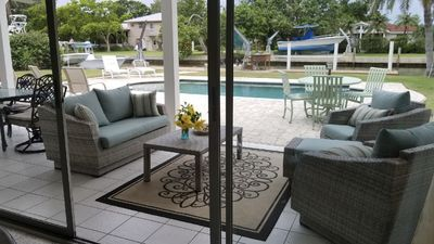 Photo for Private Heated Pool, Beach, 3/2 Old FL Charm Canal Front Home - Perfect Getaway