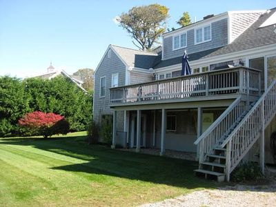 Exterior back of house and green grassy lawn - 13 Monomoy Circle Chatham Cape Cod New England Vacation Rentals