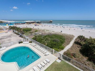 Photo for Oceanfront condo w/ balcony & shared pool - steps to the beach & near the pier!