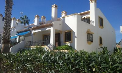Photo for Corner villa, family friendly, beautiful gardens, golf, sea & services close by