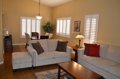 Living room, dining room, vaulted ceilings throughout home