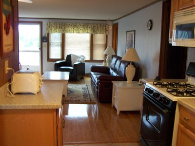 Photo for Beautiful 3 bedroom cottage with huge deck and walk to private beach!