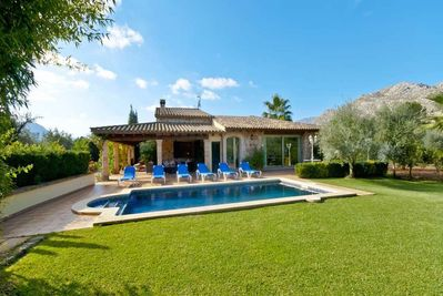 Spacious garden with mountain views from the pool
