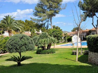 Photo for Cozy house in beautiful communal garden with large swimming pool