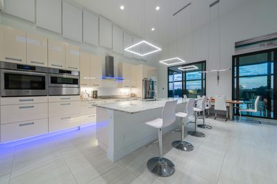 View to the modern kitchen in high-gloss finish
