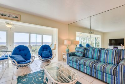 Living room with lanai and Gulf of Mexico in background