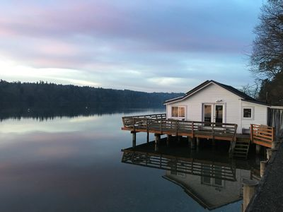 Our eco-cottage in high tide stillness over the Salish Sea.
