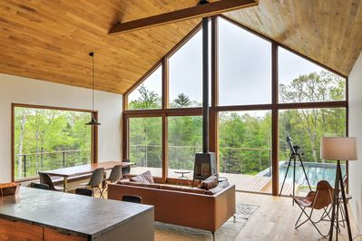 The interior has cathedral ceilings, floor-to-ceiling windows and gorgeous views